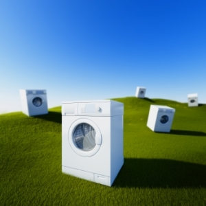 Washing machines on green grass field(clean the nature concept)